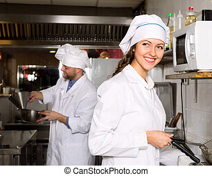 Professional chefs working at take-away