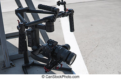 Professional cinema digital video camera on a 3-axis gimbal. Videographer using steadicam.