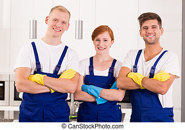 Professional cleaners in uniforms