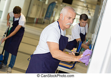 professional cleaners team in uniform working