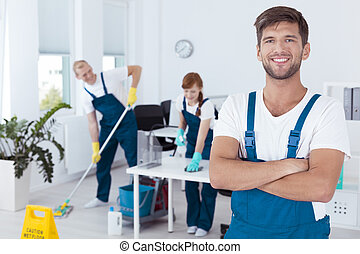 Professional cleaners working - Professional cleaner and his...