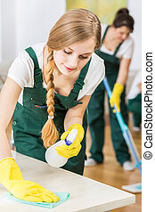 Professional cleaning lady in uniform during work
