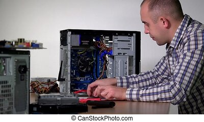 Professional computer service specialist man install ram...
