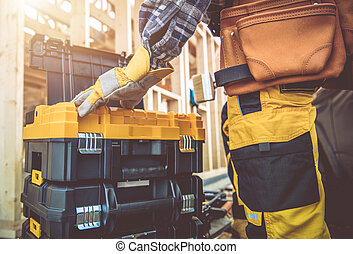 Construction Contractor Worker and His Tools Boxes
