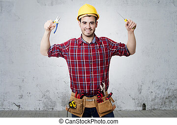 professional construction with screwdriver and pliers