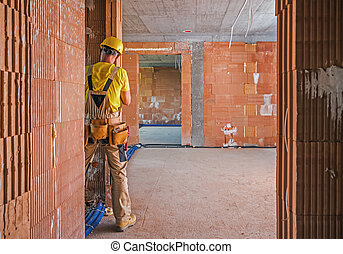 Professional Construction Worker Inside Brick Built Building
