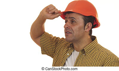Professional contractor looking shocked wearing hardhat