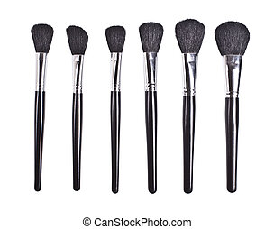 professional cosmetic brushes on white background