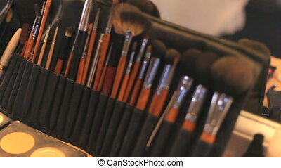 Professional cosmetics makeup on the table in the studio. Professional makeup brushes.