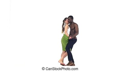 Professional couple of social latin dancers european girl with ponytail and afro american man with naked torso continue dance dancing isolated on white background, slow motion