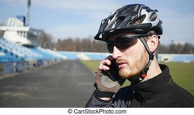 Professional cyclist speaks by phone