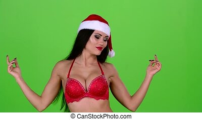 Professional dancer in the costume of a woman santa. Green...
