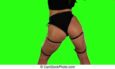 Professional dancer of twerk actively moving. Green. Slow motion