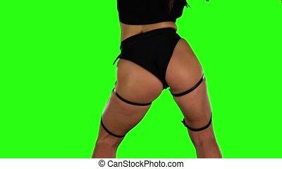 Professional dancer of twerk actively moving. Green. Slow...