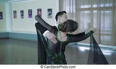 Professional dancers dancing in ballroom, 4k