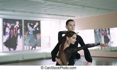 Professional dancers dancing in ballroom. Latin. 4K