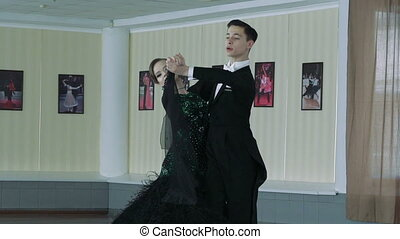 Professional dancers dancing in ballroom, slow motion