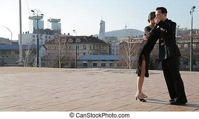 Professional dancers dancing in the street of Sarajevo,...