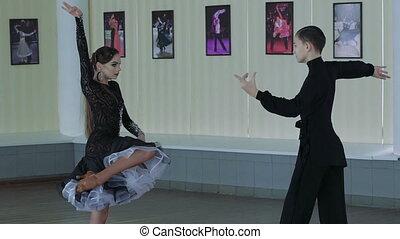 Professional dancers dancing in ballroom. Latin. Slow motion