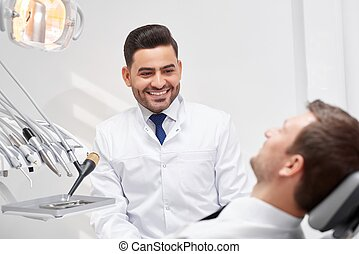 Professional dentist at his clinic