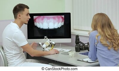 Professional dentist is receiving patient in dental clinic