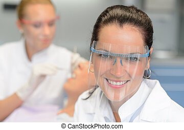 Professional dentist protective glasses patient checkup