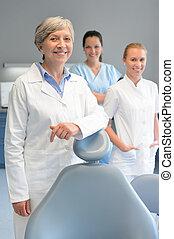 Professional dentist team woman at dental surgery -...