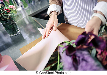 Professional designer working with plants in floral studio
