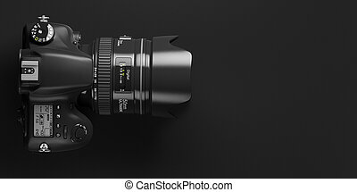 Professional digital photo camera on black background. Top view and space for text.