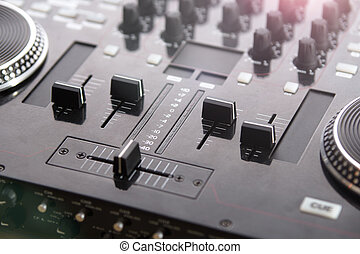 Professional DJ Console with blurred background - DJ console...