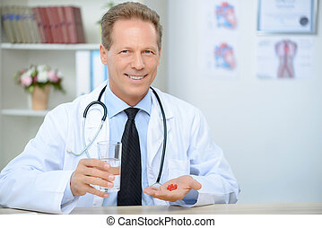 Professional doctor giving pills