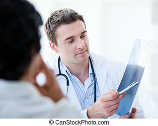 Professional doctor showing the results to his patient