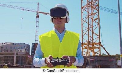 Professional drone operator in virtual reality helmet ...