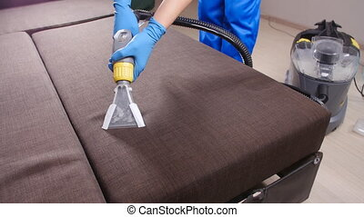 Professional dry cleaning of a sofa. The concept of cleaning...