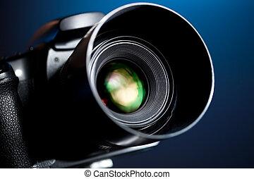 Professional DSLR camera on blue background.