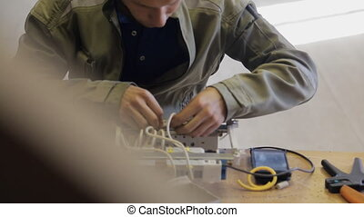 Professional electrician connects a safety switchgear using crimp.