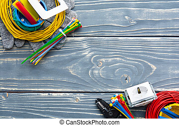 Professional electrician set on gray wooden background