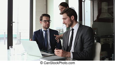 Professional employees team use laptop work in collaboration...