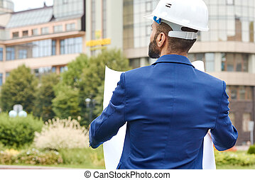 Professional engineer posing outdoors