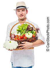 Professional farmer with a harvest of vegetables on a white background