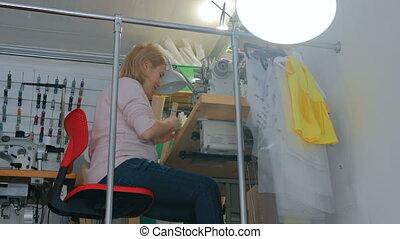 Professional fashion designer working at sewing studio -...