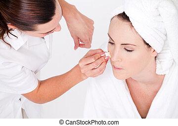 makeup artist applying makeup - professional female makeup ...