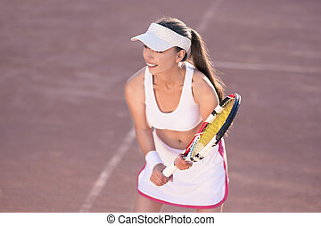 Professional female Tennis Player on Tennis Court