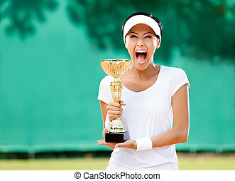 Tennis player won the cup at the sport competition. Award