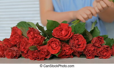 Professional floral artist working with flowers at studio
