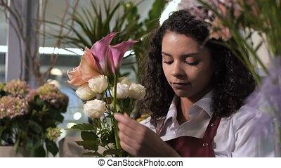 Professional florist creating bouquet of flowers - Closeup...