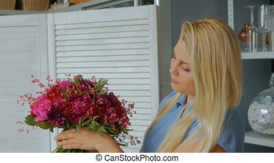 Professional florist making floral wedding composition at...