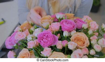 Professional florist showing bouquet at studio