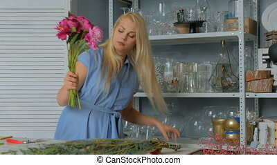 Professional florist working at flower store