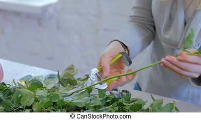 Professional florist working with flowers at studio